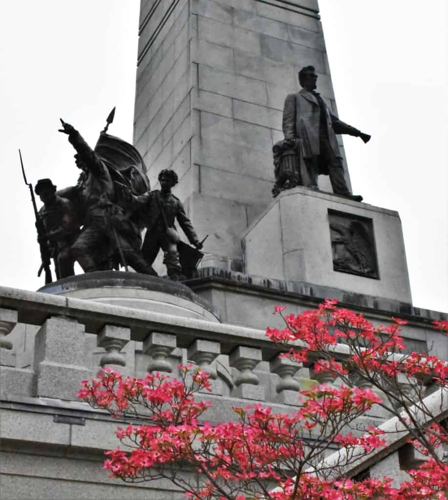 Statues adorn the obelisk at Lincoln's Tomb.