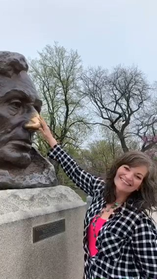 Crystal rubs the nose on the Lincoln bust for good luck.