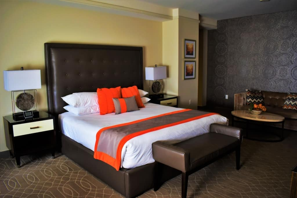 The bright pop of color in the bedspread added an air of casualness to the elegantly decorated boutique hotel room.
