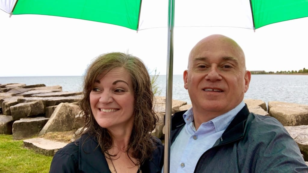 The authors stop for a selfie under gray skies.