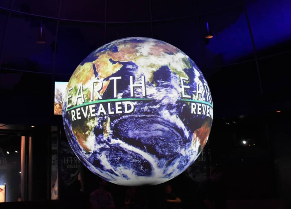 The earth revealed exhibit uses satellite photos to explain everyday patterns.