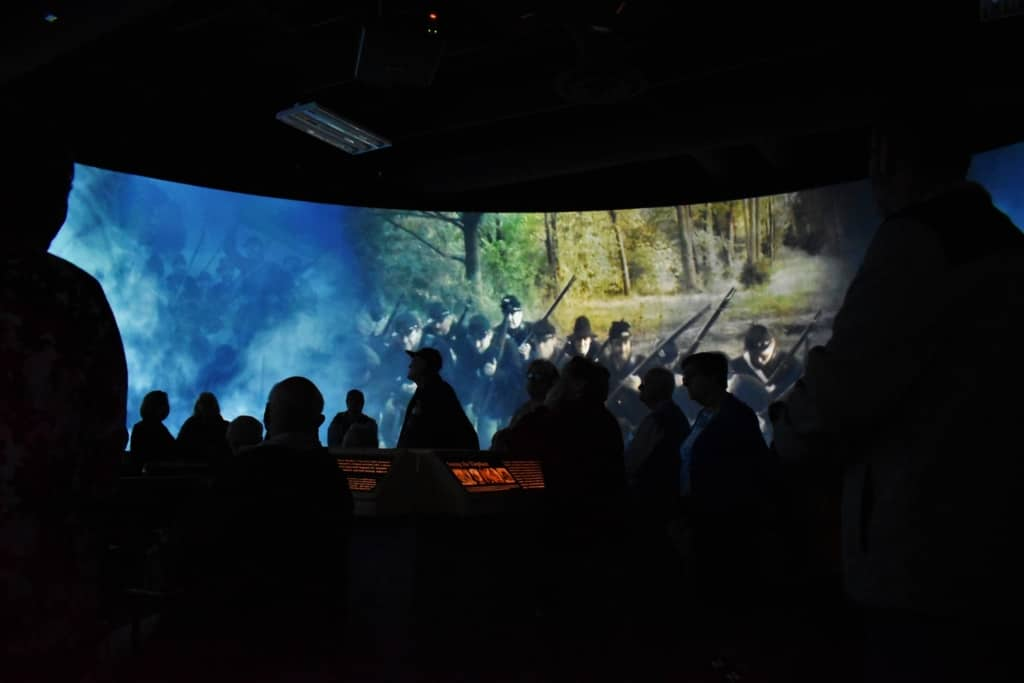 A surround movie experience draws visitors into the battlefield.