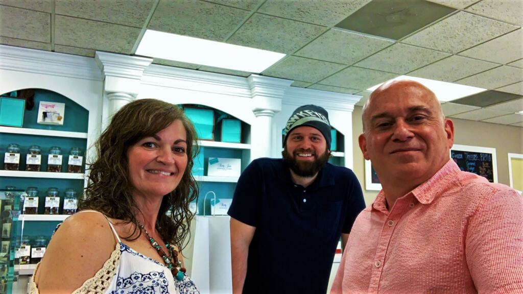 The authors pose for a selfie with the president of Betty Jane candies.