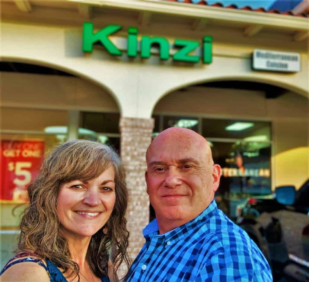 The authors pose for a selfie after a dinner at Kinzi.
