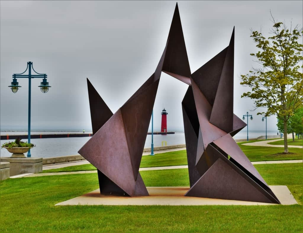 The Kenosha Lighthouse is framed by a piece of art in a nearby park.