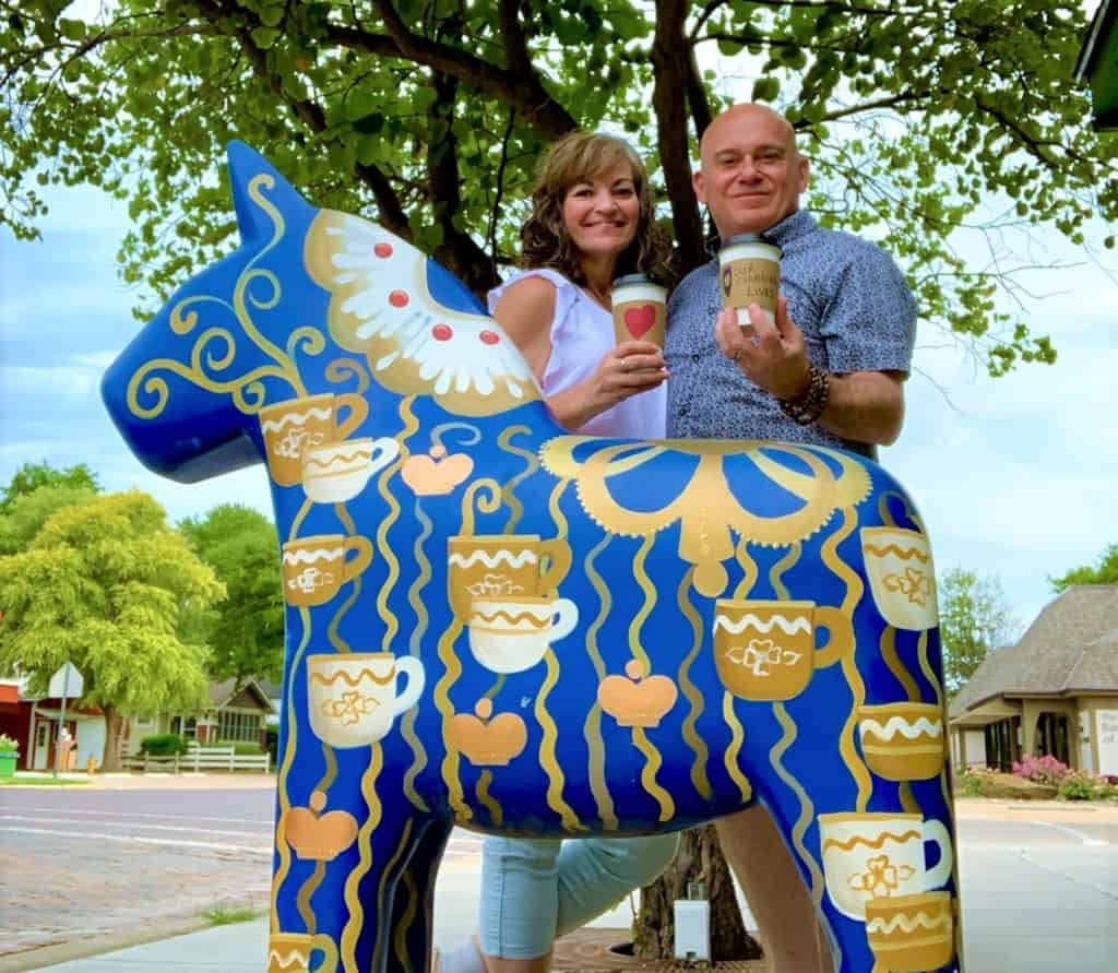 The authors pose for a selfie in front of one of the wild Dala horse herd creations.