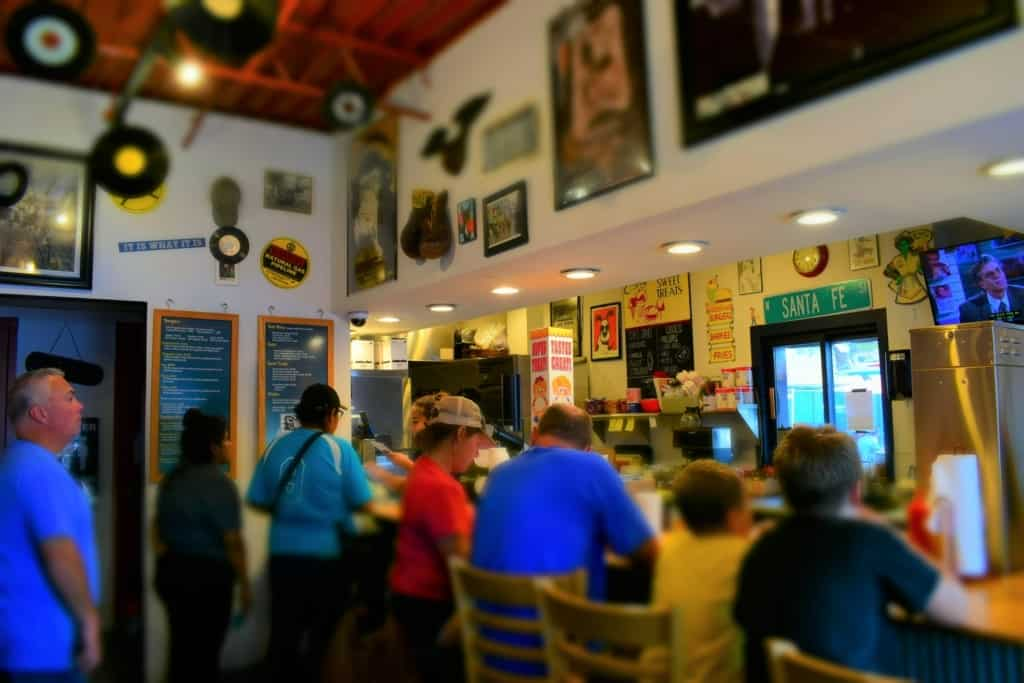 The tight space at The Snack Shack on Santa Fe can become filled with hungry diners on any given day.
