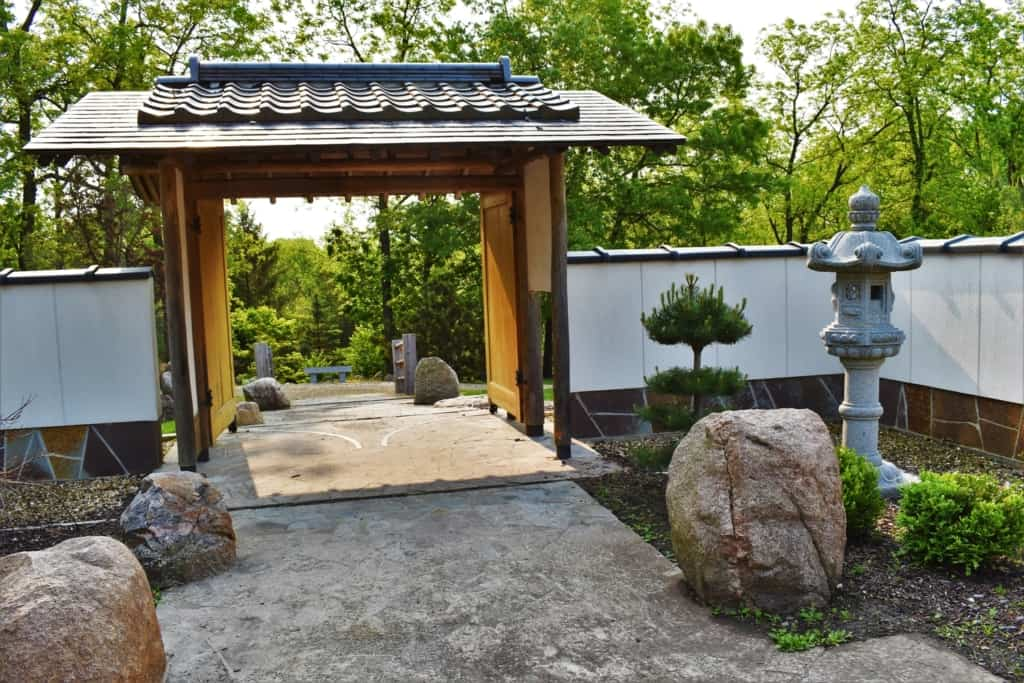 Stepping through the Japanese garden Gate leads to a tranquil garden.