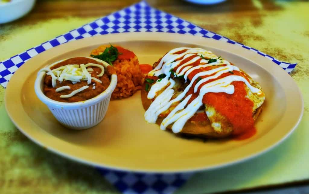 The Chicken Enchilada is a beautifully designed dish that incorporates fried eggs into the meal.