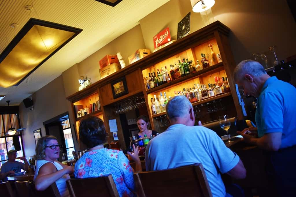 The bar at L. May eatery is a social hot spot for locals and travelers alike.