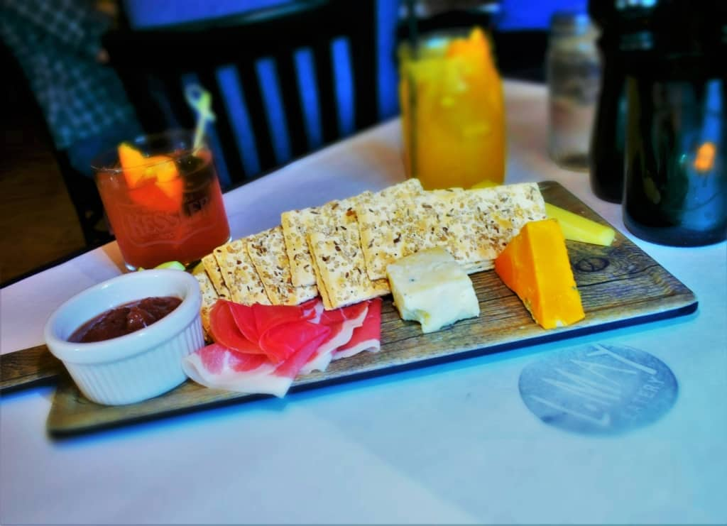 A charcuterie sampler is the perfect thing to break the ice at this social hot spot.