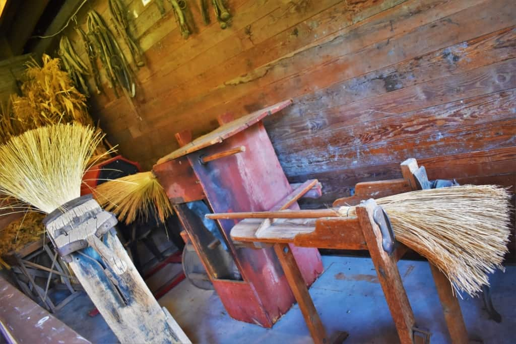 One of the exhibit buildings included examples of broom making tools.