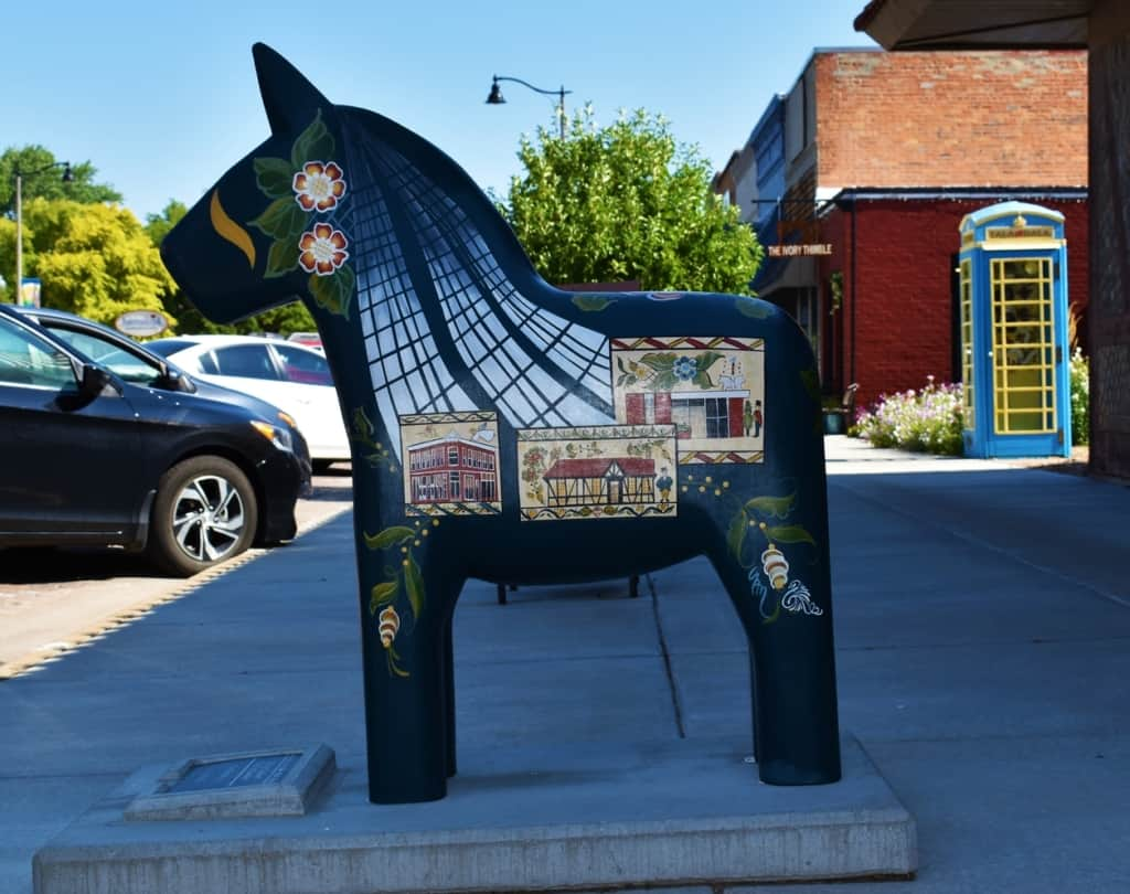 A Dala horse stands at attention along Main Street in Lindsborg, Kansas.
