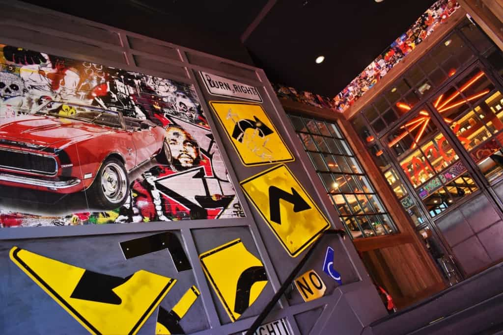 Guy Fieri's iconic red Camaro can been seen pictured in a mural at the entrance to his Kansas City restaurant.