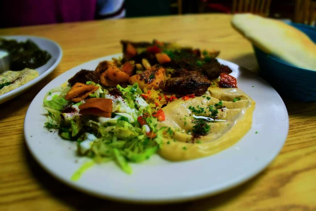 The Mashawi Mix Plate offers tastes of the various grilled meats found on Middle eastern kabobs.