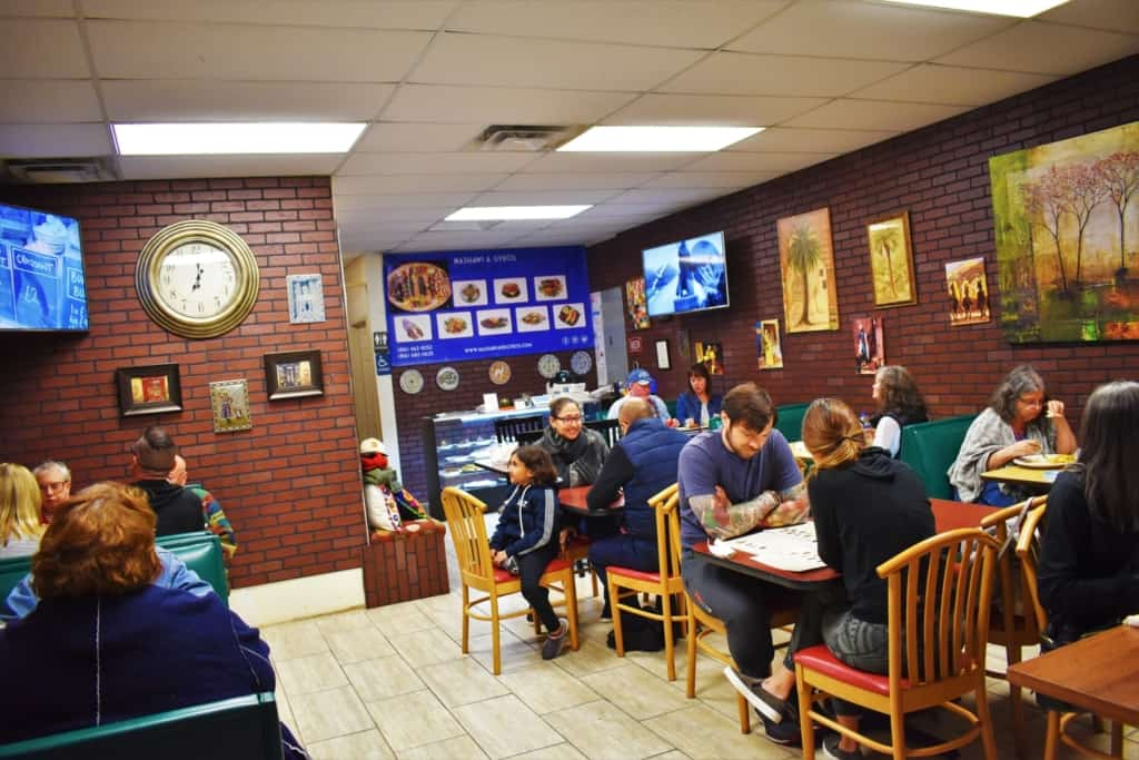 Dinnertime draws in hordes of locals to enjoy the delectable dishes at Queen Sweets Bakery in Kansas City.