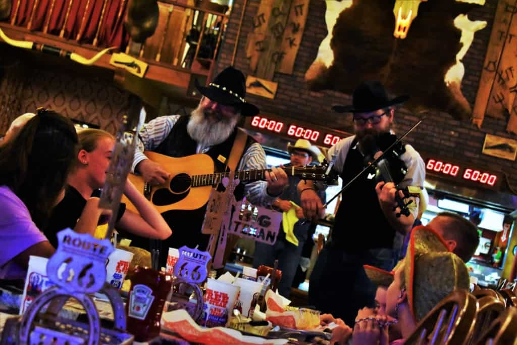 Strolling musicians channel the cowboy spirit as they entertain the diners at The Big Texan.