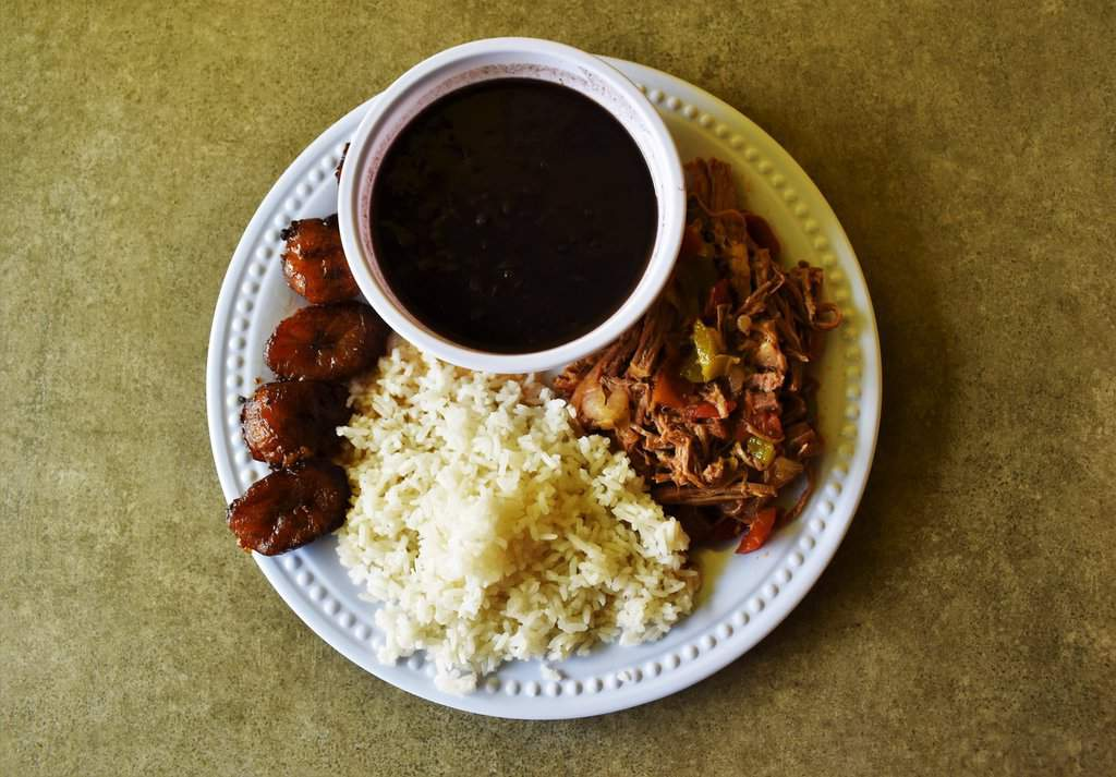 A tempting plate of Cuban food is awaiting visitors to Chips & Coins in KCK.
