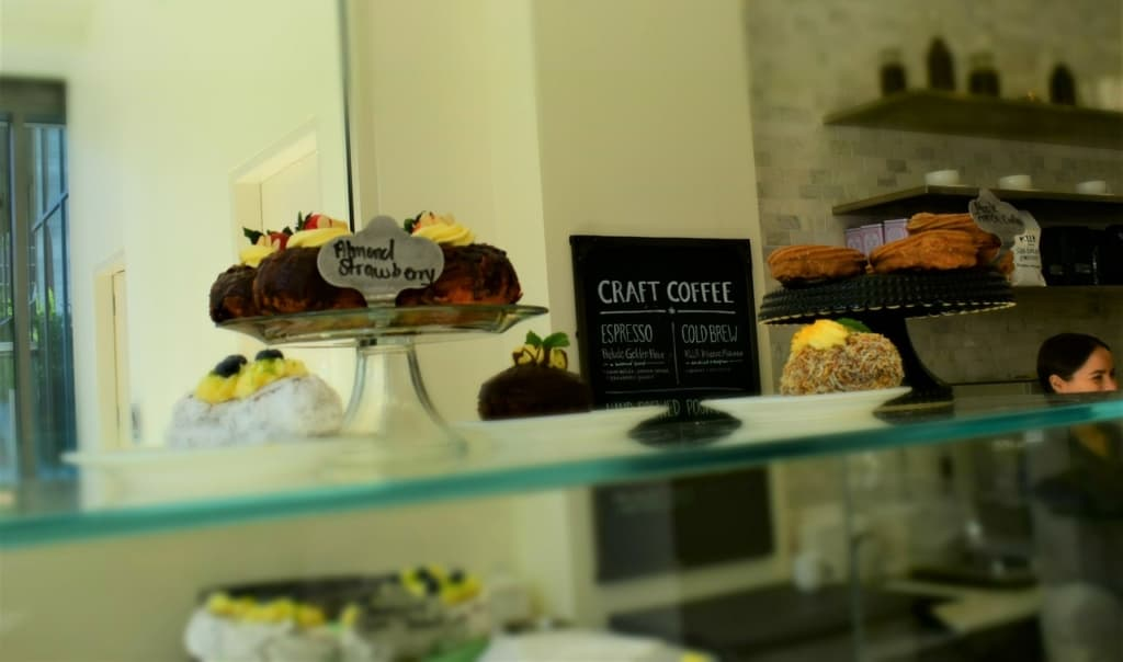 A beautifully decorated pastry case tempts diners who visit Kitchen 324.