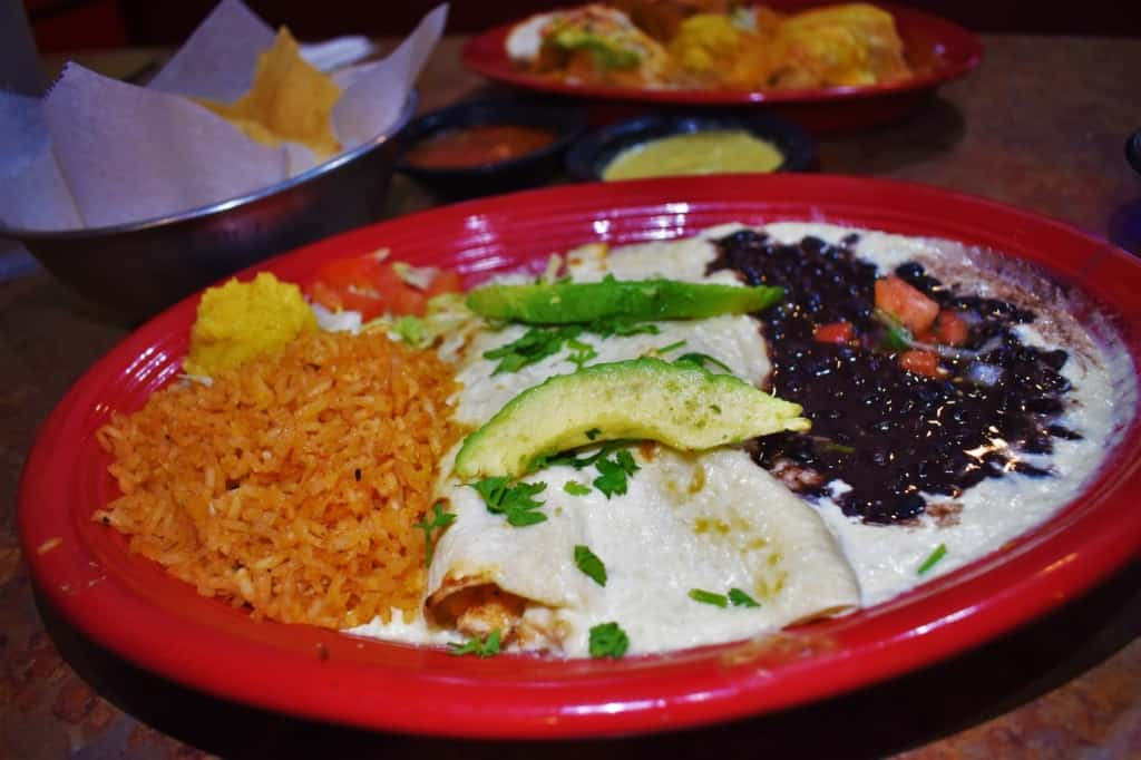 The cream Cheese Chicken Enchilada plate is filled with color and flavor.