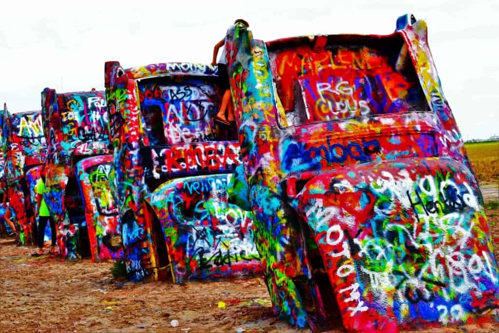 The brightly colored cars are part of the ever changing landscape found on Route 66, near Amarillo, Texas.