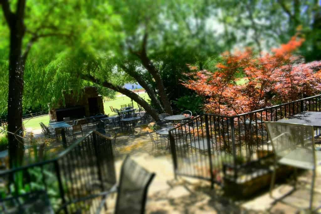 A shaded patio is an inviting spot to enjoy some Bedlam Bar-B-q, while listening to local entertainers.