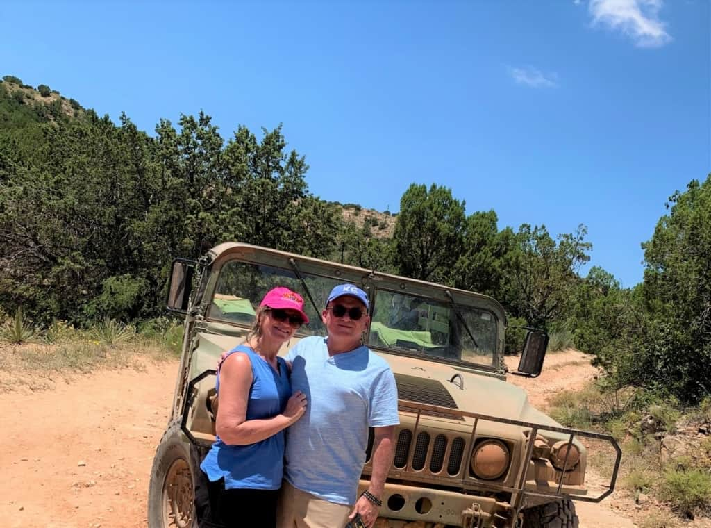 The authors pose for a selfie with the jeep that they rode in during their tour at Palo Duro Creek Ranch.