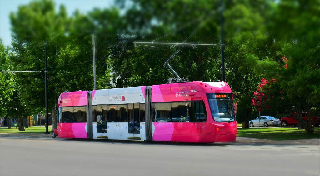 The brightly colored OKC Streetcar is easy to spot as you wait for a ride.