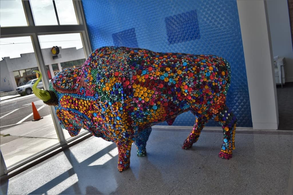 An artistic bison keeps watch over the OKC Streetcar line.