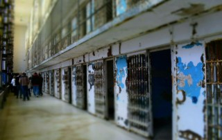 Walking the block at the Missouri State penitentiary included a view of the cells that once housed five prisoners each.