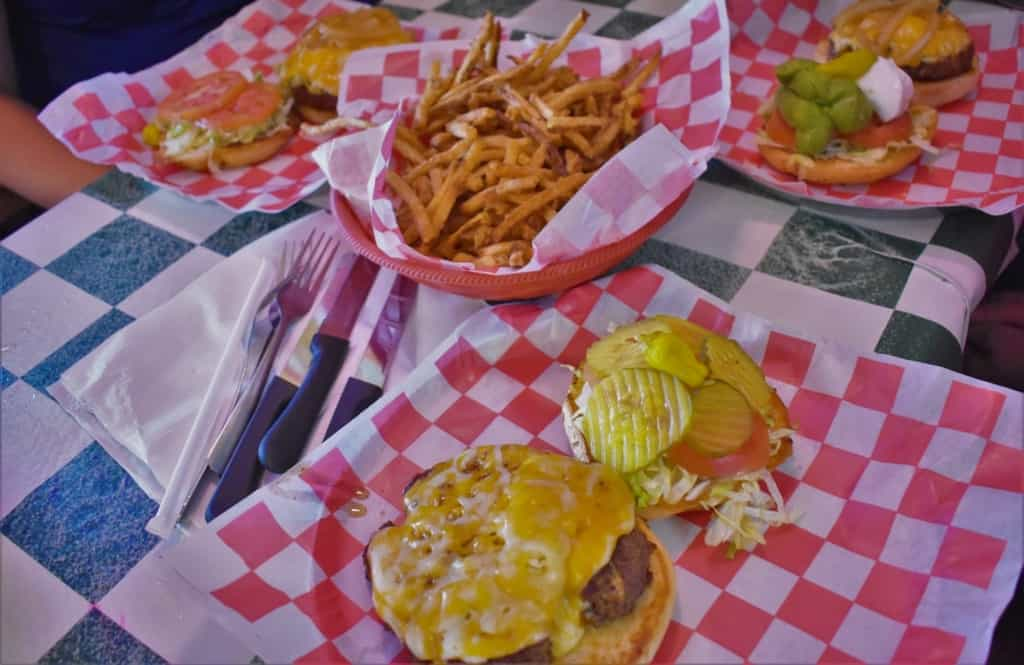 A table full of burgers and French fries makes a great scene for lunch at Coyote Bluff Cafe.
