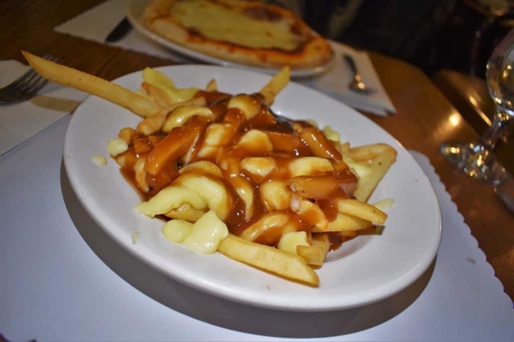 Poutine and pizza make for a carbolicious meal that can be found in Quebec City.