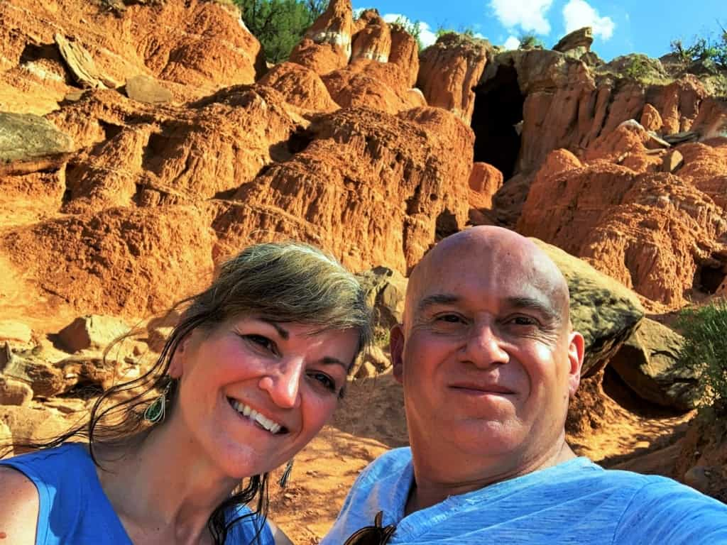 The authors pose for a selfie after exploring a cave.
