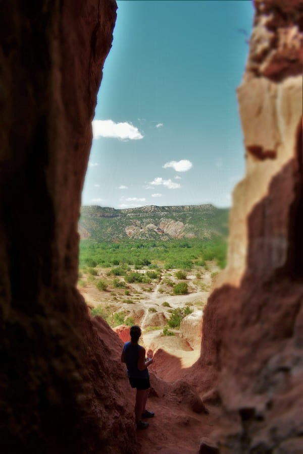 Standing in the shade of a cave gave us an opportunity to gaze at the beauty of the Canyon.