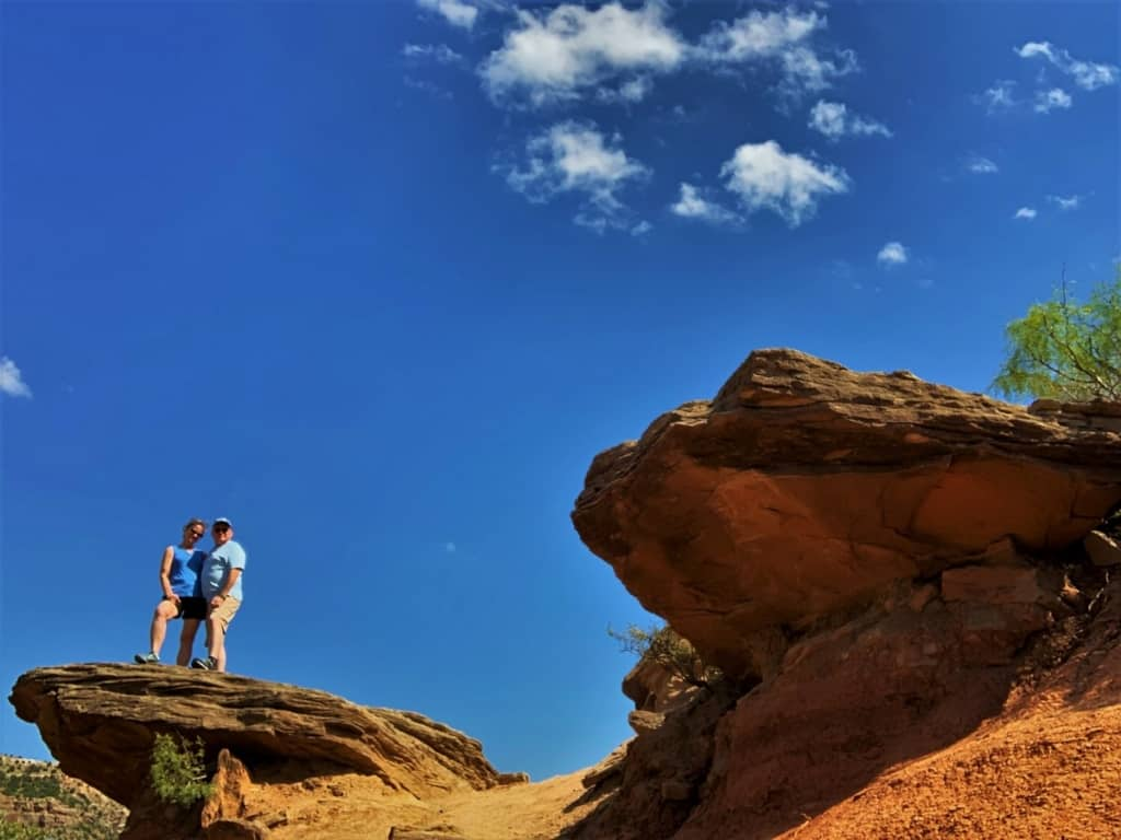 The authors pose on a rocky outcropping on the floor of Palo Duro Canyon.