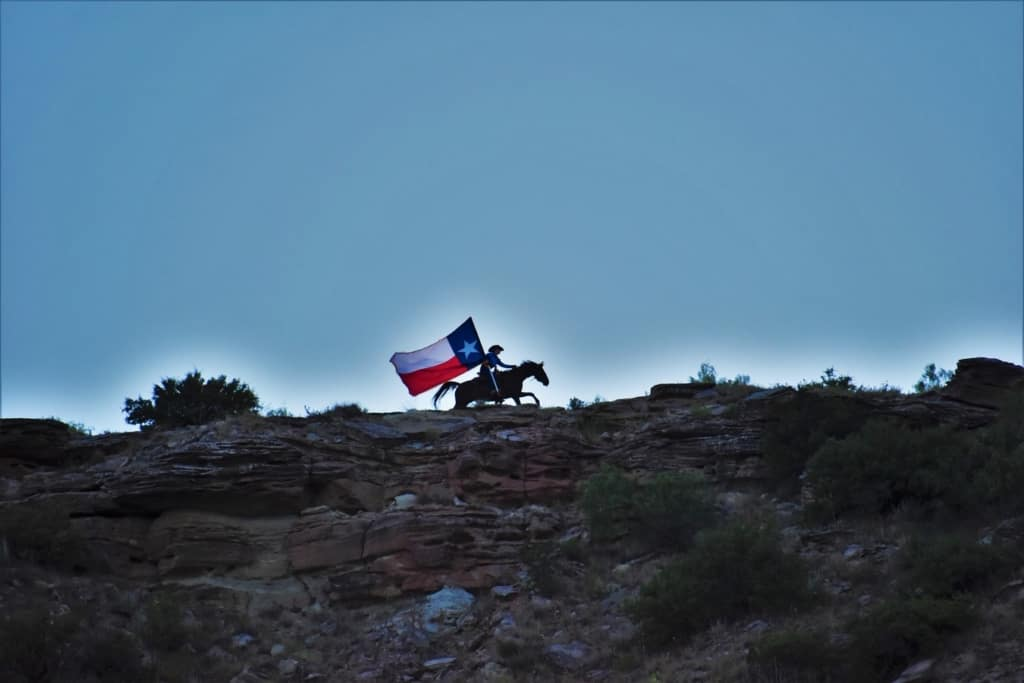 A lone rider gallops along the ridge overlooking the stage of Texas Outdoor Musical.
