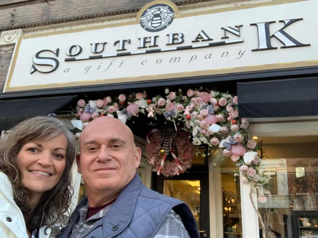 The authors pose for a selfie outside of a boutique-style shop in downtown Jefferson City.