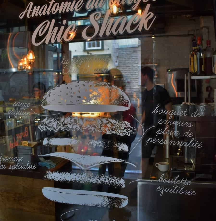 The signage entering Le Chic Shack includes plans for building the perfect burger.