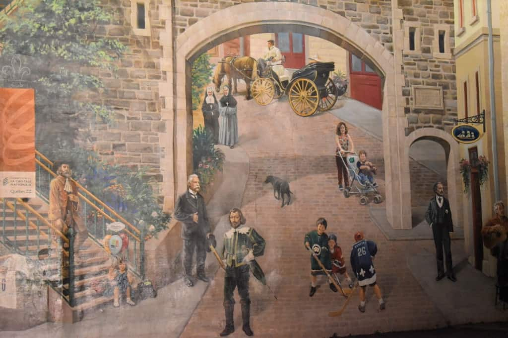 Notable characters are accounted for in this mural near Place Royale.