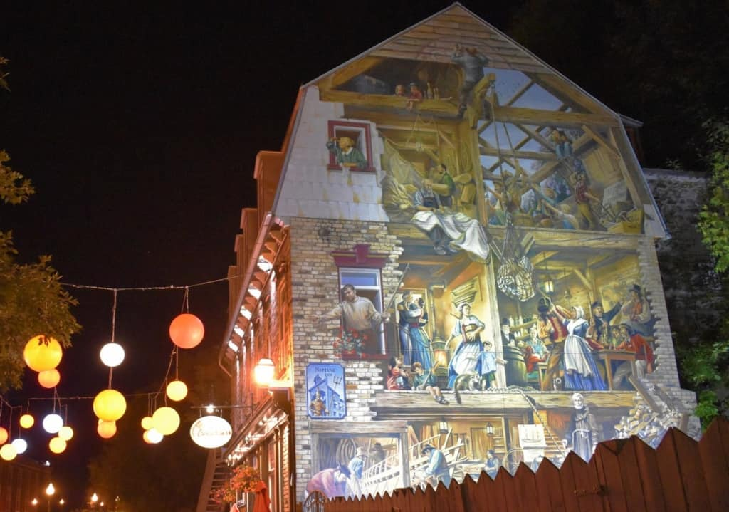 Some of the buildings in Quebec City have huge murals that help tell the history of the city.