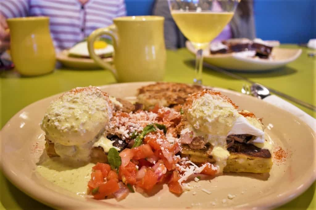 Looking for something new is easy at Snooze, since they have a menu filled with unique dishes like the Chili Verde Benedict.