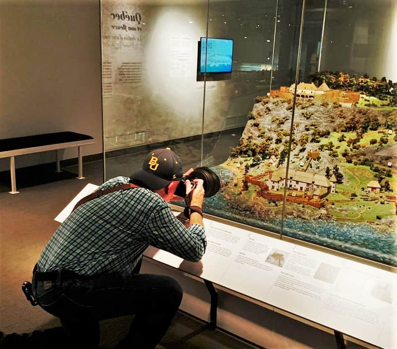 The author uses various techniques, while capturing history for an article.