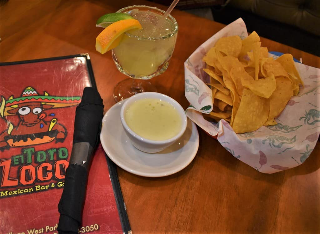 An evening of dining at El Toro Loco included queso dip, tortilla chips, and a house margarita.