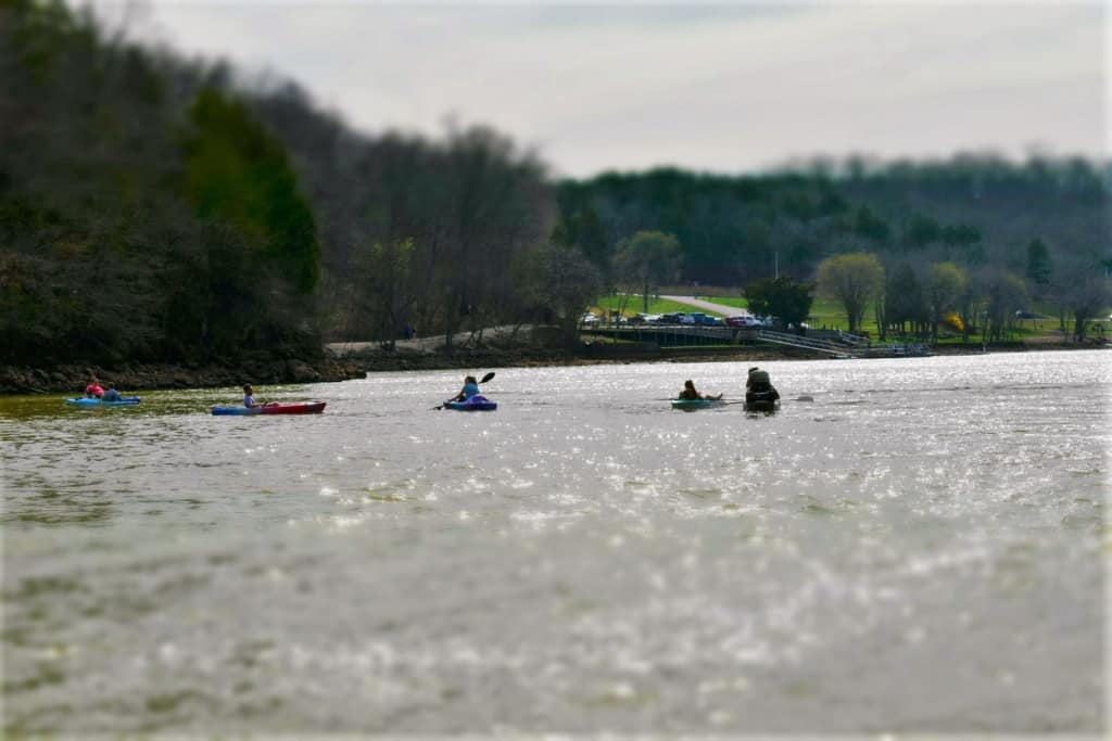 Kayakers paddle slowly across the waters that flow from ha Ha Tonka Spring.