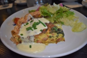 Summit Grill is dressing up brunch with a delightful serving of quiche.
