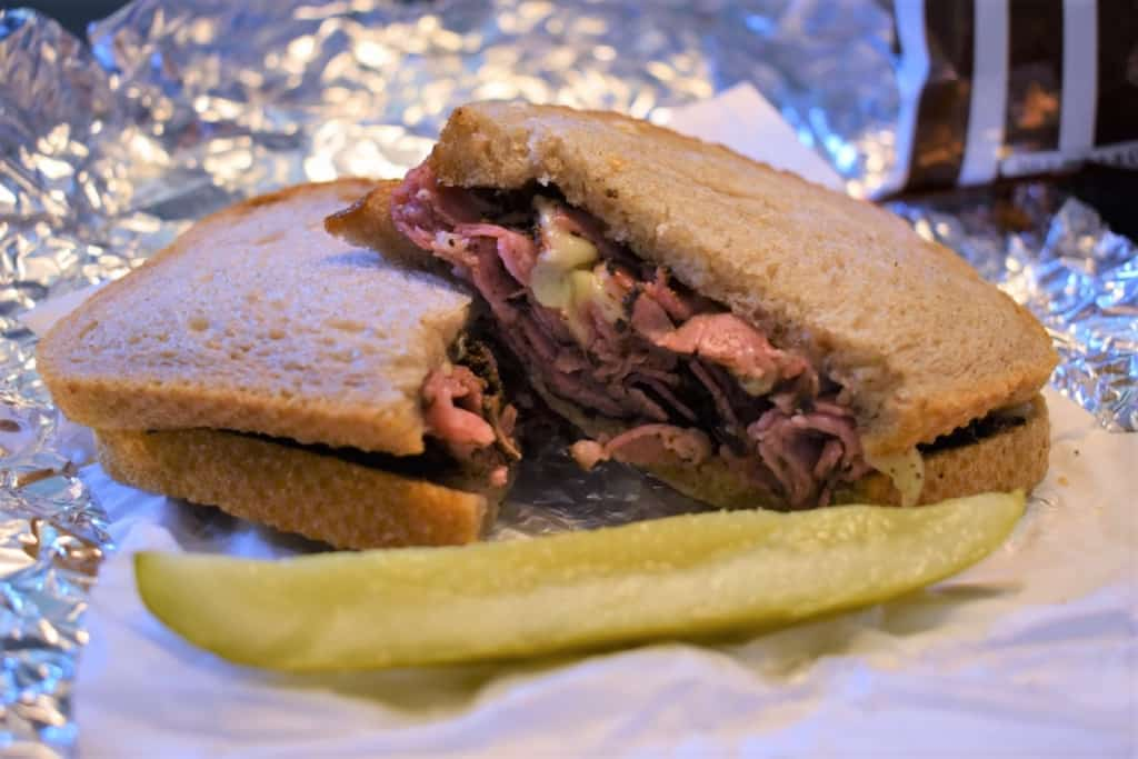 A close-up of the Pastrami Sandwich makes for a mouth-watering picture.