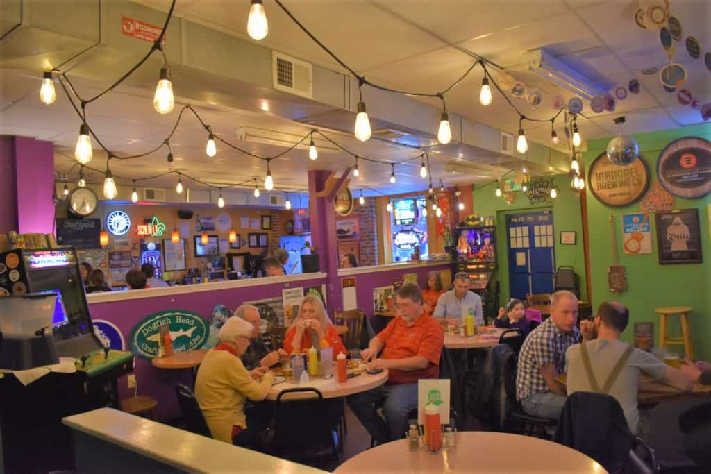 The seating space in green Room Burgers a & Beers is designed for socializing, not social distancing.