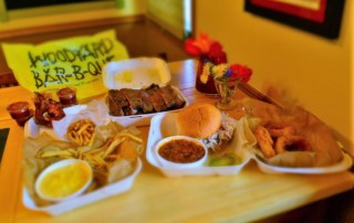A smorgasbord of barbecue dishes are avaiable by using creative carryout methods.