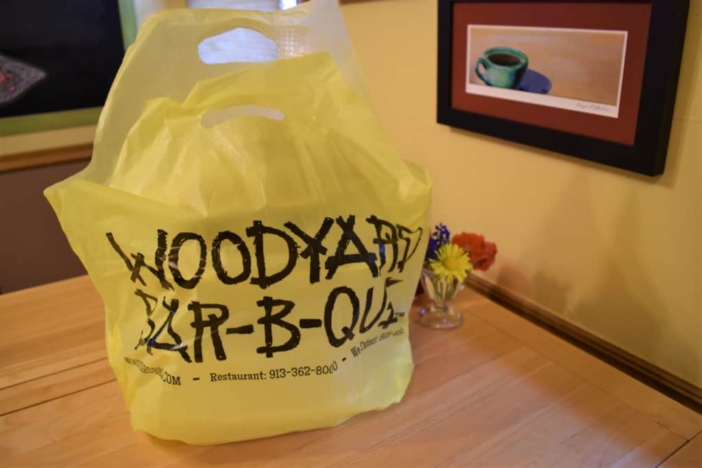 A bag filled with creative carryout options to be eaten at home.