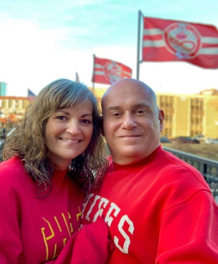 The authors are all decked out in their Chiefs gear to celebrate the Super Bowl win.